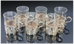 Victorian Set Of Six Fine Silver Embossed Spirit Holders containing six glass drinking vessels.