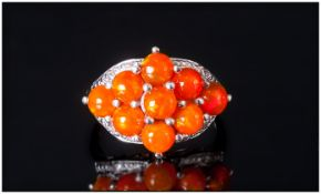 Orange Ethiopian Opal Cluster Ring, nine round cut cabochons of the unusual orange opal,