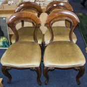 Set of Six Walnut Framed Dining Chairs of solid construction. Carved front cabriole legs with padded