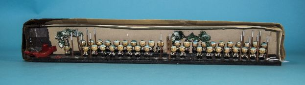 Boxed Oriental Peg Figures, Approximately 50 On A Base All Painted With Various Stab/Spear Marks