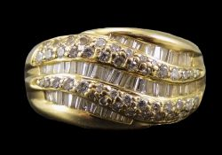 14 Carat Gold Set Baguette and Brilliant cut Diamond and Channel Set Cluster Ring comprises three
