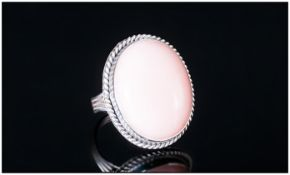 Pink Opal Solitaire Ring, an oval cut cabochon of a generous 28cts of the ethereal pink oval,