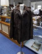 Ladies Three Quarter Length Coney Jacket. Hook and eye fastening with rever collar and slit pockets.