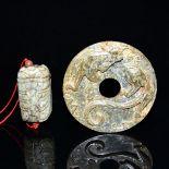 古玉掛飾兩件:螭龍璧,玉蟬 Two Archaistic Jade Pendants Carvings: Qilin Bi and Cicada. Diameter: 2⅝ in (6.7 cm)