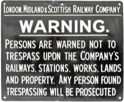 LMS enamel Trespass Sign, white lettering on black ground measuring 22in x 18in. Good colour and