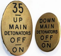 GWR oval brass Signalbox Lever Leads, a pair comprising: 35 UP MAIN DETONATORS OFF ON; DOWN MAIN