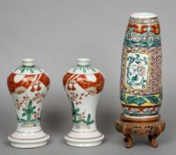 A pair of 19th century Japanese Kutani porcelain vases Typically decorated; together with an unusual