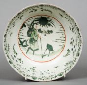 A Japanese porcelain bowl Decorated in green enamels with a continuous garden landscape, the