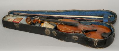 Two cased violins