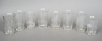 Eight Swedish Art Deco beakers, possibly Orrefors Each etched with various stylised sporting scenes.