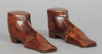 A pair of carved wood snuff mulls modelled as boots Each with removable cover and brass stud