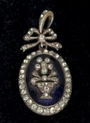 A 19th century blue enamel and paste set yellow metal backed pendant Of oval form, centred with an