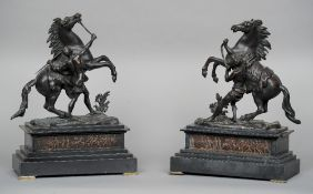 A pair of late 19th century patinated bronze Marley horses Each typically modelled, standing on a