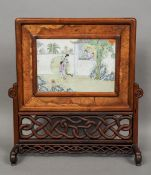 A Chinese porcelain plaque Decorated with female figures in a garden, two further figures leaning