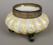 A Victorian opalescent glass vase  Of ribbed form with painted scrolling foliate decoration, the rim
