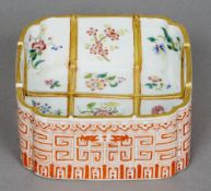 A 19th century Chinese porcelain square pot The interior decorated with floral spray trellis, the