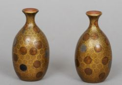 A pair of small 19th century Japanese lacquered vases Each decorated with roundels on a gilt