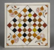 A specimen marble inset chessboard The white marble body with various specimen inlays.  34 cm