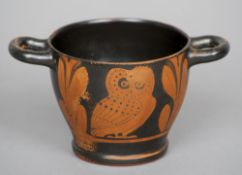 An ancient Greek attic style twin handled vessel The exterior decorated with owls and foliage.  15