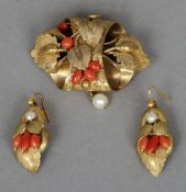 A 19th century coral and pearl set Pinchbeck brooch together with a pair of earrings en suite The