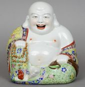 A Chinese famille jeune porcelain model of Buddha Typically modelled seated, the underside with