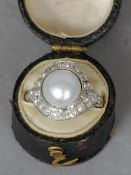A fine quality natural pearl and diamond Art Deco ring set in platinum