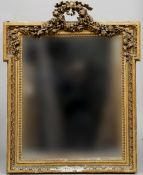 A Victorian carved giltwood and gesso framed wall glass Of stepped rectangular form headed with a