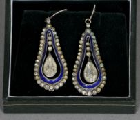 A pair of 19th century blue enamel and paste set white metal backed earrings Pear shaped with