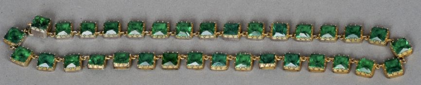 A 19th century green paste set necklace The stones square cut.  40.5 cms long. CONDITION REPORTS: