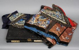A quantity of Chinese silk items Including: sleeves, a collar, and a skirt, each intricately