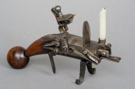 An 18th century tinder lighter Typically modelled.  18 cm long. CONDITION REPORTS: Generally in good