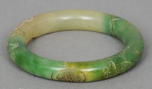 A Chinese carved jade type bangle  With incised decoration.  8 cm diameter. CONDITION REPORTS: