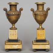 A pair of 19th century Sienna marble and bronze cassolets Each bronze urn with lion mask handles