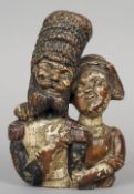 A 19th century polychrome decorated carved wooden figural group Formed as a Russian Hussar and his