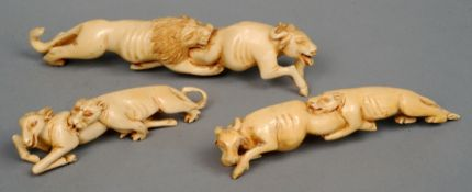 Three African carved ivory animal groups Each modelled as a lion making a kill.  The largest 28