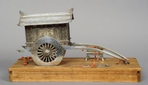 A fine quality Chinese unmarked silver model of a rickshaw  With engraved and cast decoration, the