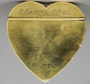 A late 18th/early 19th century brass heart shaped snuff box The hinged lid inscribed F. Kemp, Hull