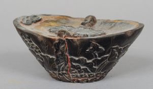 A Chinese carved horn paperweight Of lobed oval form, the top decorated with fish, the underside