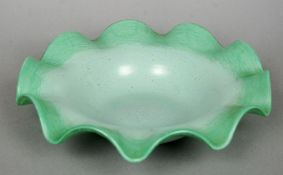 A Vasart glass bowl Of low crimped form, decorated in green tones.  28 cm diameter. CONDITION