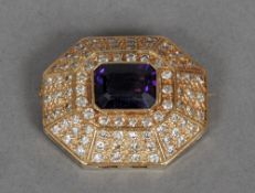 An unmarked gold, diamond and amethyst brooch