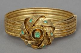 A 19th century green stone set yellow metal bracelet The adjustable band mounted with an entwined