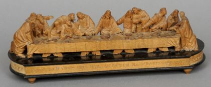 A 19th century carved fruitwood diorama of the Last Supper Of typical form, standing on an inscribed