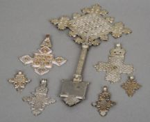 A quantity of Irish silver coloured metal cross pendants and a staff The latter 29.5 cms high.