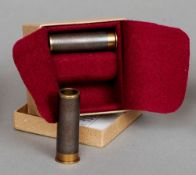 A boxed pair of 28 bore snap caps made from damascus barrels Each with inscribed initials to the