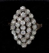 A 19th century gold and silver rough cut diamond set ring Of navette form.  2.25 cm high.