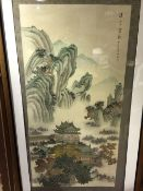 A large Chinese watercolour  Depicting pagodas in a mountainous landscape and with calligraphy,