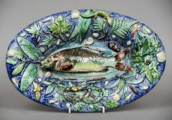 A 19th century Palissy ware majolica dish Of oval form centred with fish bordered by a lizard and