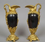A pair of gilt bronze mounted Sevres type ewers