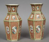 A pair of 19th century Chinese porcelain hexagonal vases Each with a cell diaper panelled ground