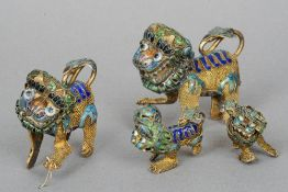 Two pairs of Chinese enamel decorated filigree dogs-of-fo Each typically modelled.  The larger